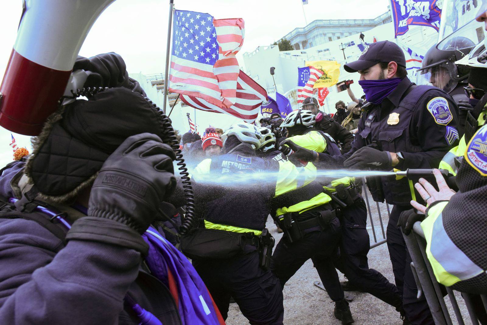 Supporters of U.S. President Donald Trump clash with police officers in front of the U.S. Capitol Building in Washington