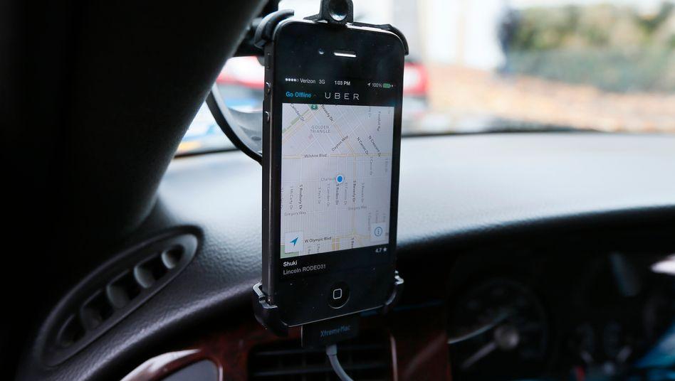 Smartphone-App: Uber ist in Neu-Delhi laut einem Bericht vorerst verboten - ebensowie Uber-Pop in den Niederlanden
