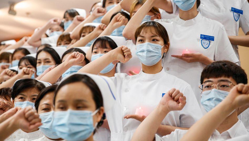 Krankenschwestern in Peking: Die Pandemie ist in China so gut wie überwunden