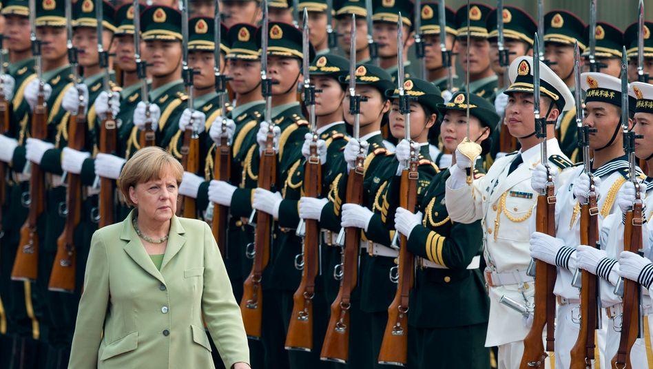 Merkel in China: Aufgabe der Bundesregierung, deutsche Firmen und deren geistiges Eigentum zu schützen