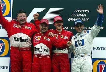 Überflieger: Michael Schumacher, Rubens Barrichello, Juan Pablo Montoya (BMW-Williams/re.) und Ferrari-Technikchef Ross Brawn (li.)