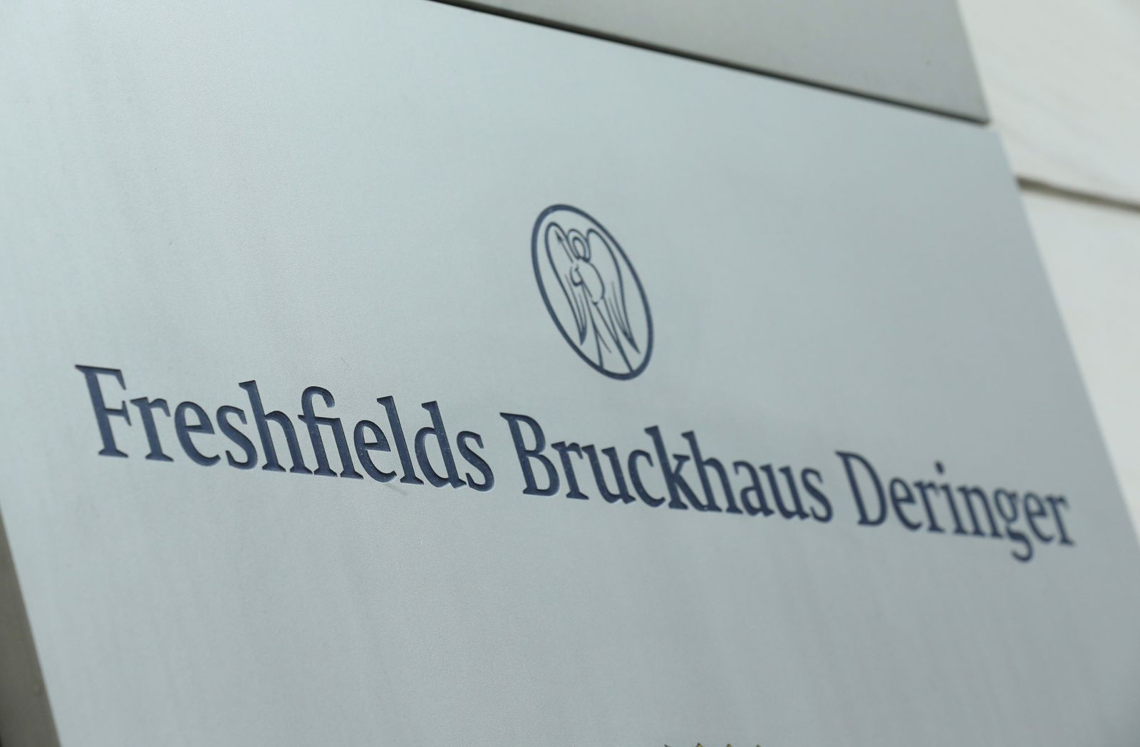 A nameplate of the Freshfields Bruckhaus Deringer LLP office is pictured in Frankfurt