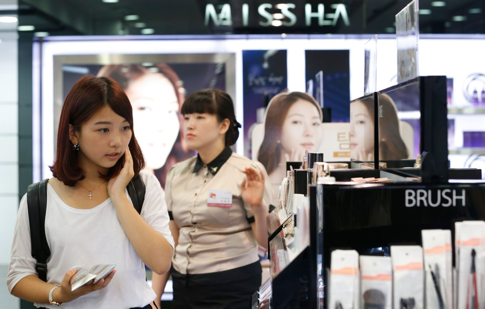 A tourist shops at a Missha store in central Seoul
