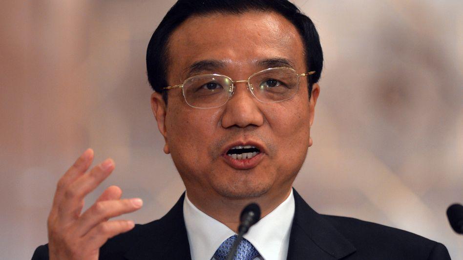 Chinas Premier Li Keqiang: Die Agentur Xinhua als Sprachrohr der Regierung warnt vor einem Eingreifen in Syrien