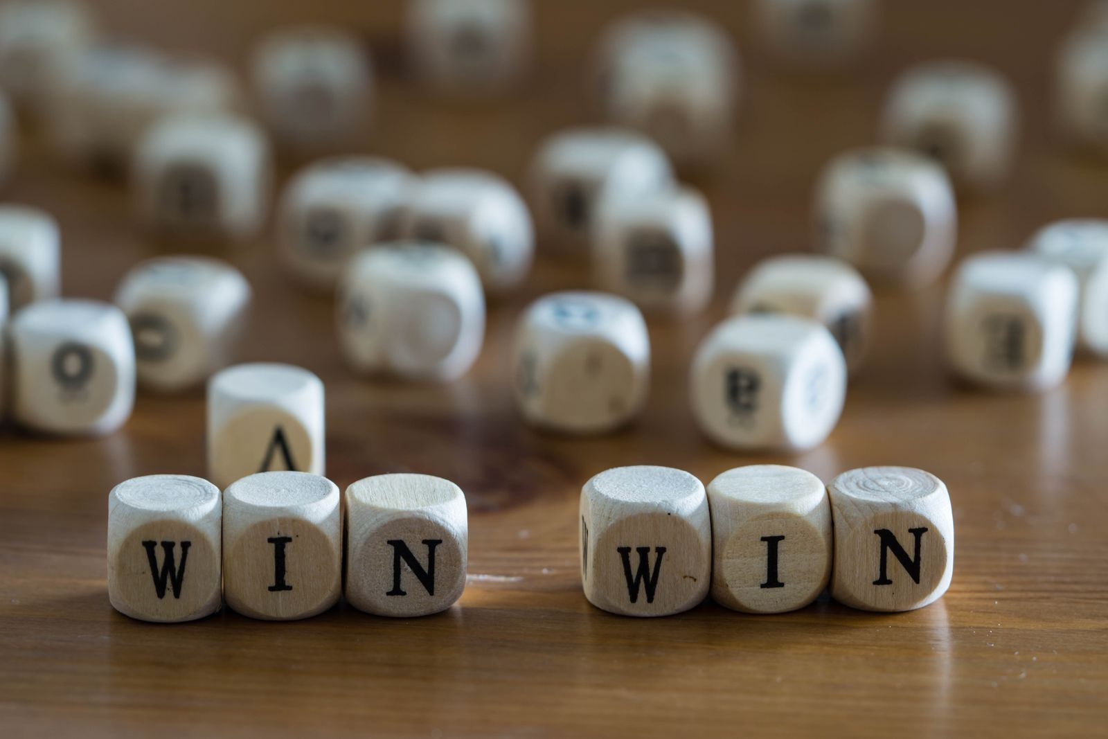 Win win written with wooden cubes