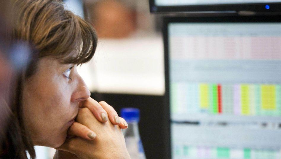 Händlerin an der Deutschen Börse: Der Dax notiert knapp unter Rekordhoch