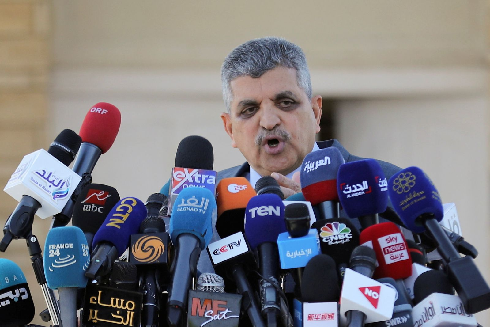 Osama Rabie, Chairman of the Suez Canal Authority, talks during a news conference in Suez