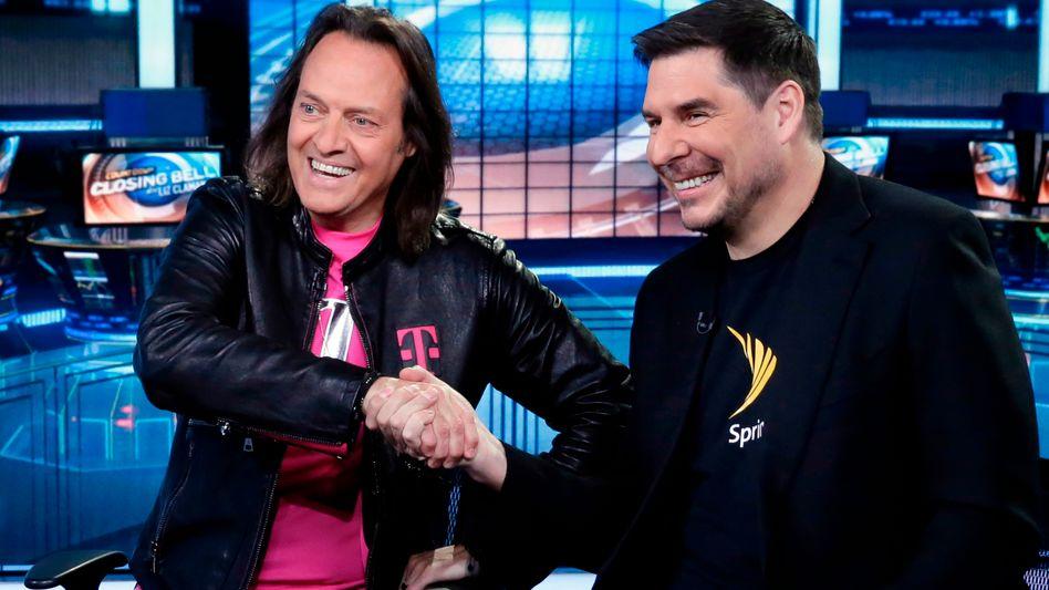 T-Mobile Chef John Legere, Sprint-Chef Marcelo Claure: Das US-Justizministerium hat dem Zusammenschluss zwischen T Mobile US und Sprint zugestimmt