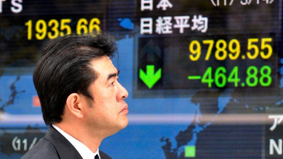 Unerfreulicher Anblick: Die Börse in Tokio geriet nach den Äußerungen von Fed-Chef Bernanke unter Druck