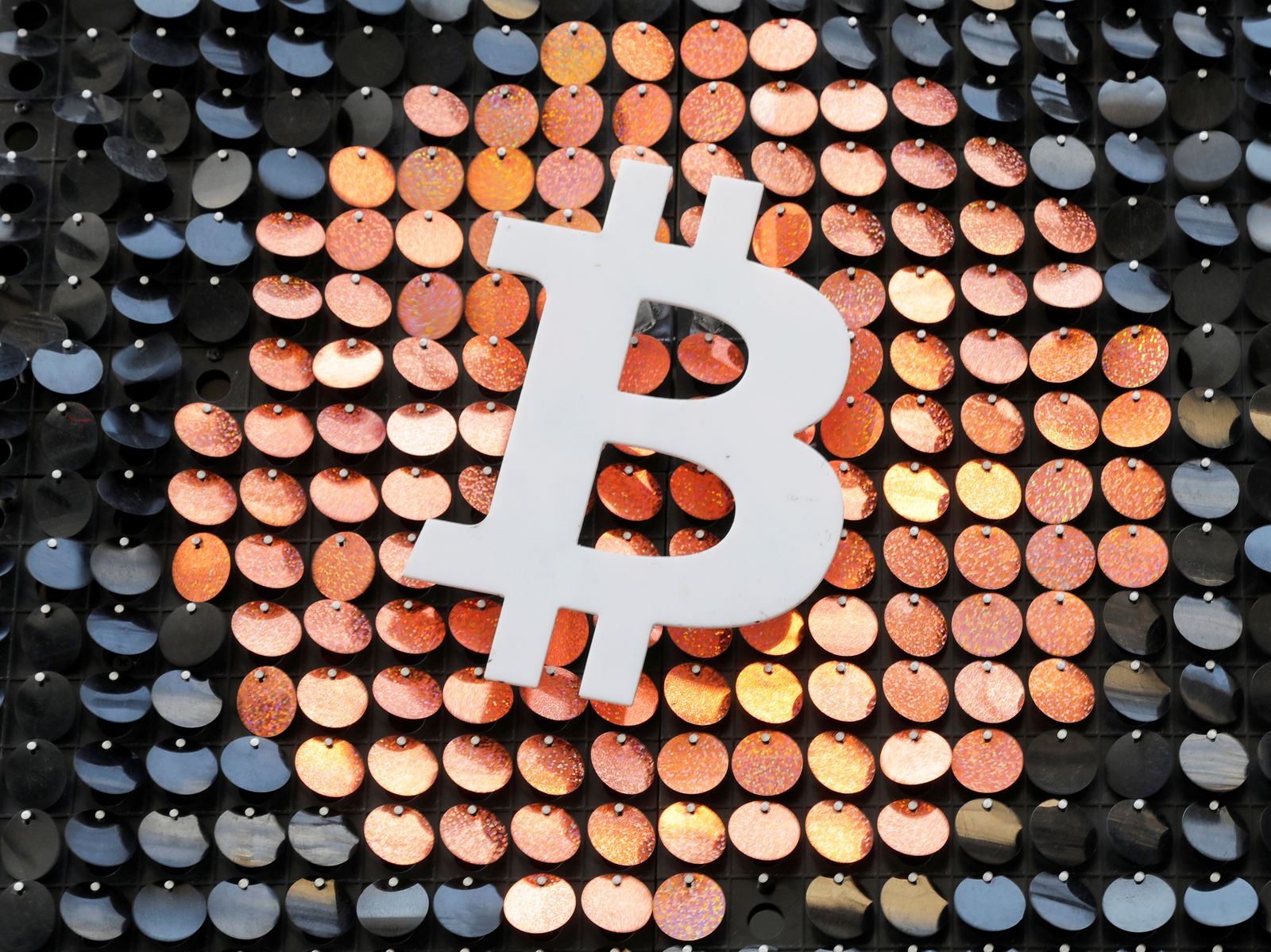 FILE PHOTO: The logo of the Bitcoin digital currency is seen in a shop in Marseille