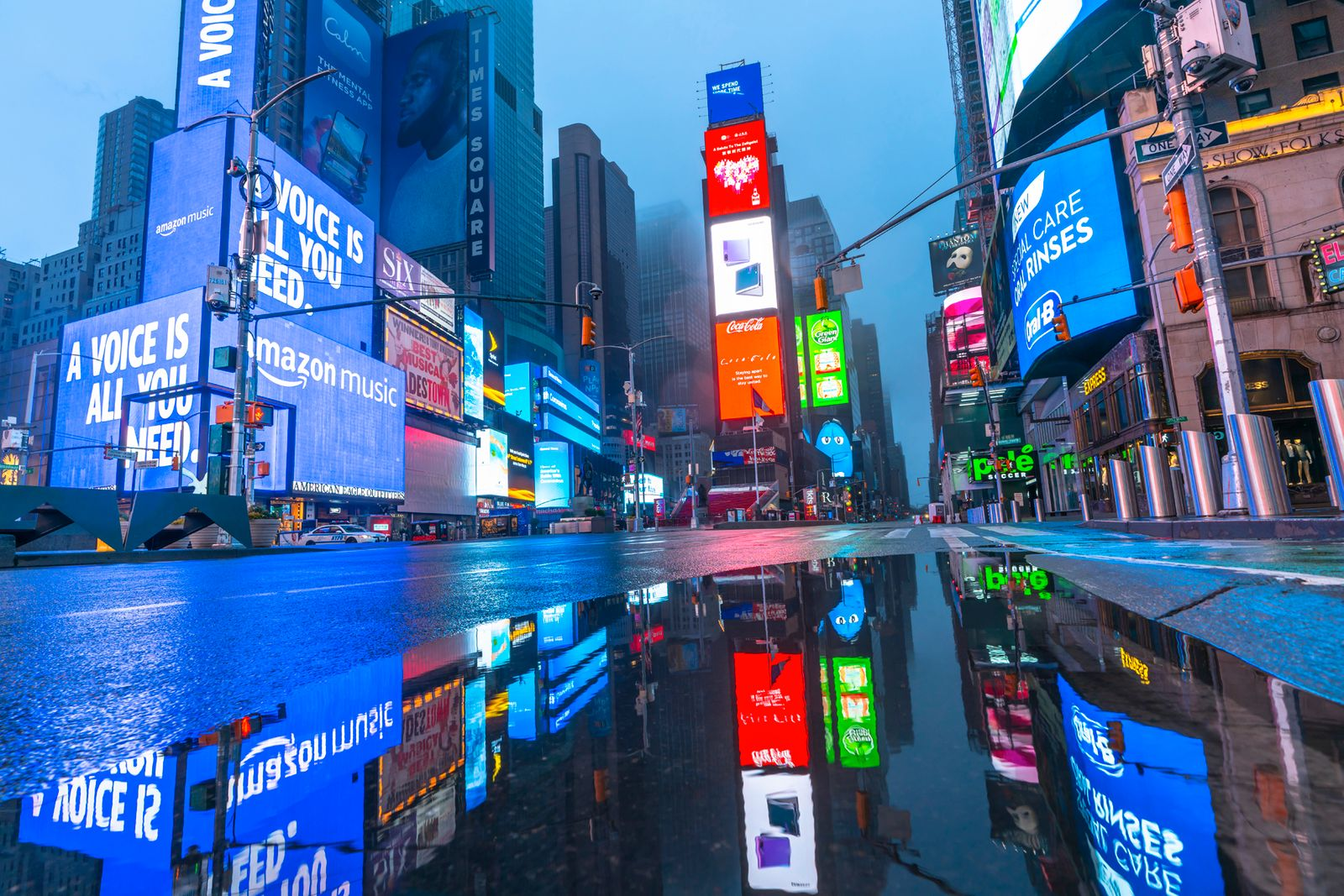 New York. People and traffic disappeared from Times Square for impact of COVID-19 in the rainy dawn New York City NY USA on Mar. 29 2020.