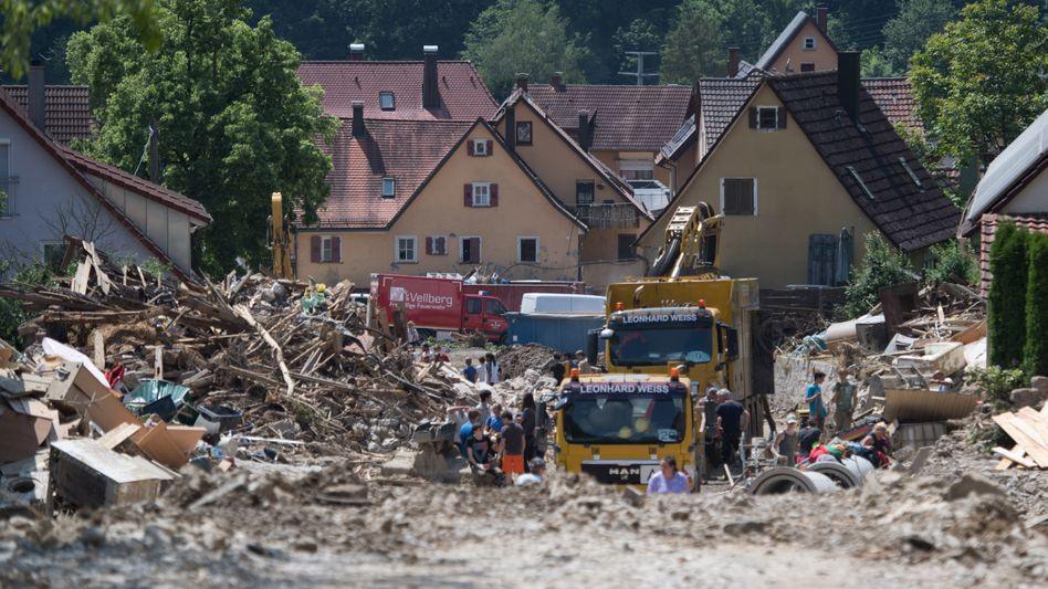 Unwetter wie in Braunsbach in Baden-Würrttemberg lassen die Gewinne der Allianz einbrechen