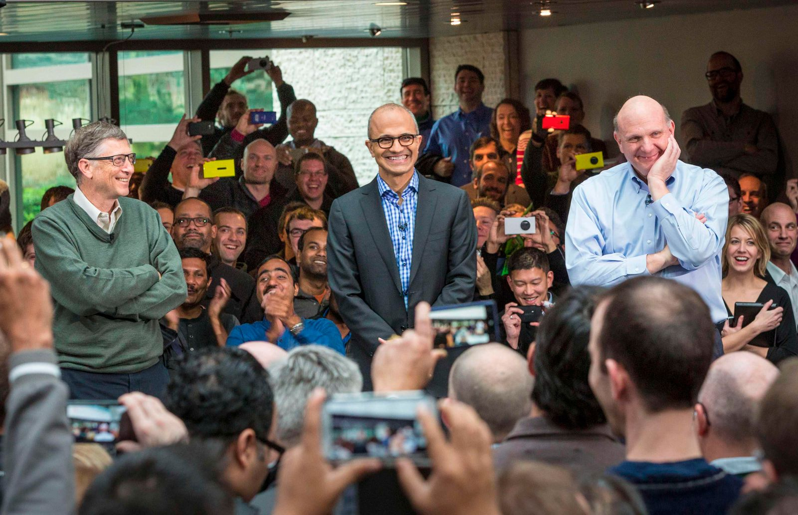Handout photo of Satya Nadella, Microsoft's new CEO, addressing employees along with founder and technology advisor Bill Gates and outgoing CEO Steve Ballmer on the company's campus in Redmond
