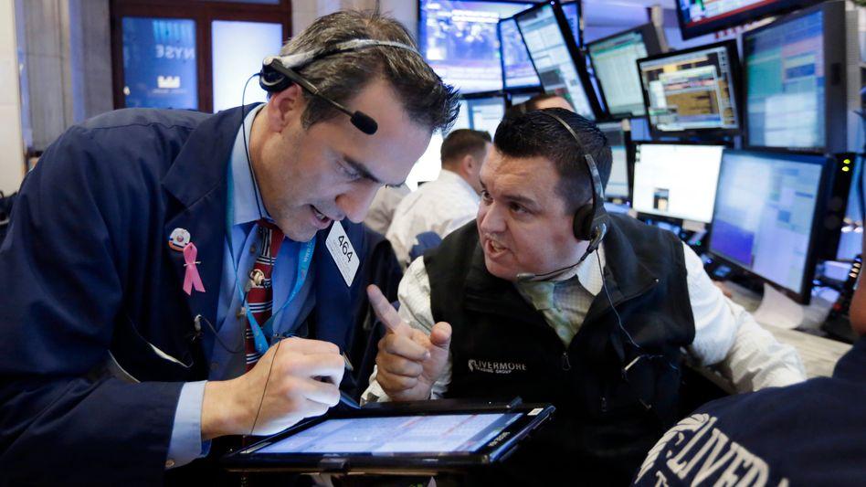 Dax und Dow im Vorwärtsgang: Zinsfantasie beflügelt die Börsen