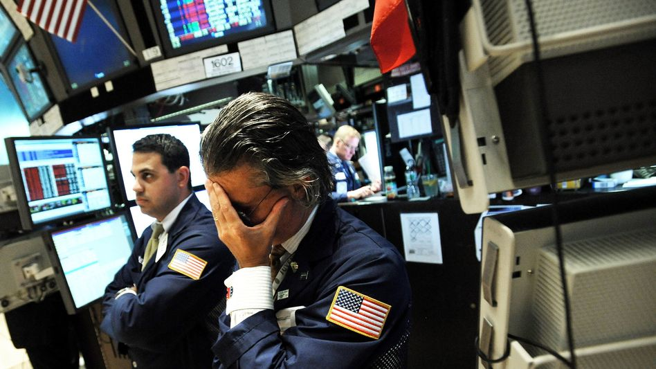 Niedergeschlagene Händler in New York: Die Finanzkrise wird zum Wirbelsturm an der Börse