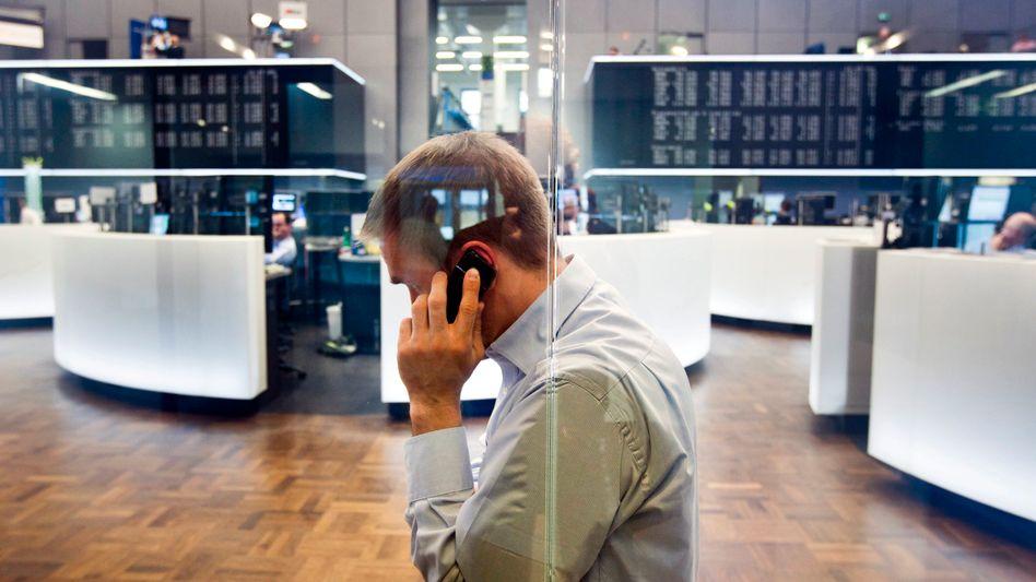 Händler an der Deutschen Börse: Der Dax notiert nahe Rekordhoch