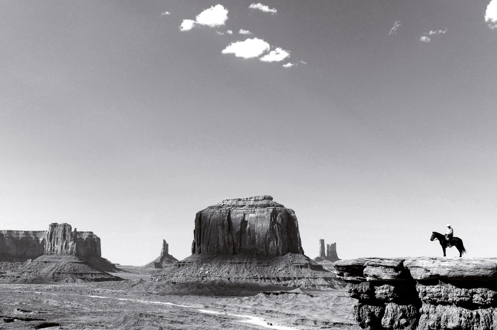 A Navaho man on horseback.