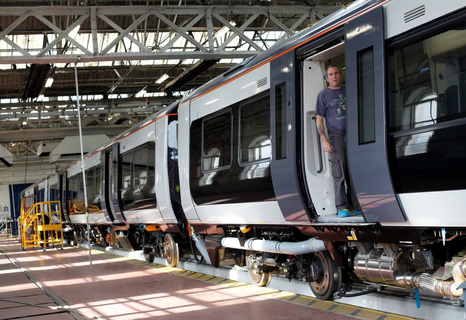 FILE PHOTO: A worker stands in the doorway of a train at the Bombardier plant in Derby