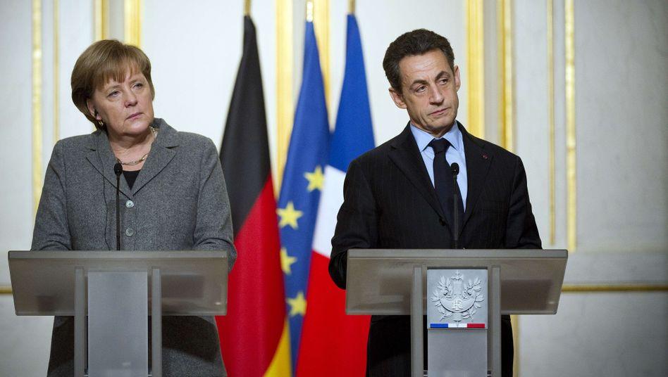 Große Ambitionen, kleine Ergebnisse: Kanzlerin Merkel und Präsident Sarkozy in Paris