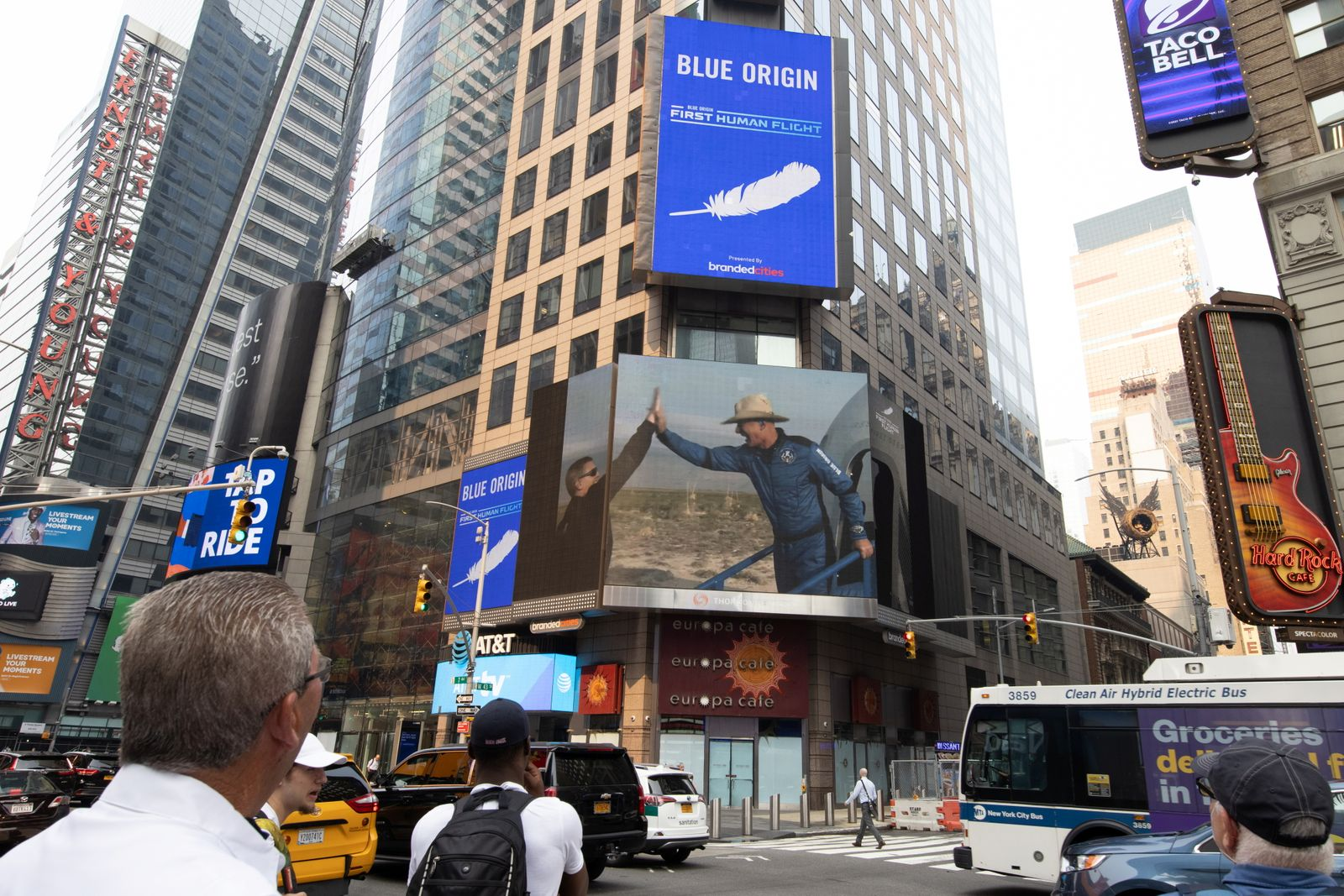 People watch the launch of Blue Origin's inaugural flight to the edge of space, on a screen in Times Square in New York