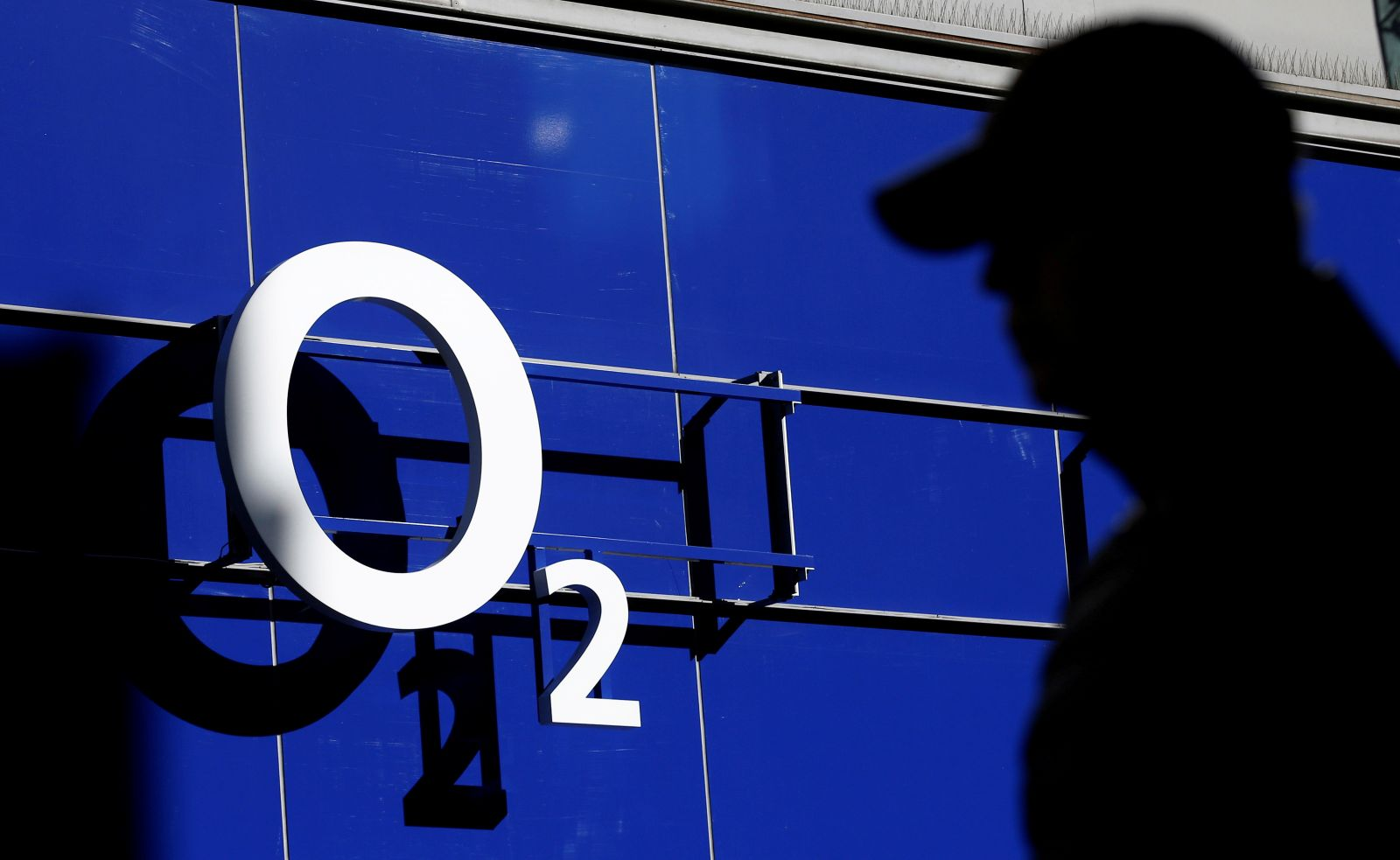 File photo of a man walking past an O2 phone store in Manchester