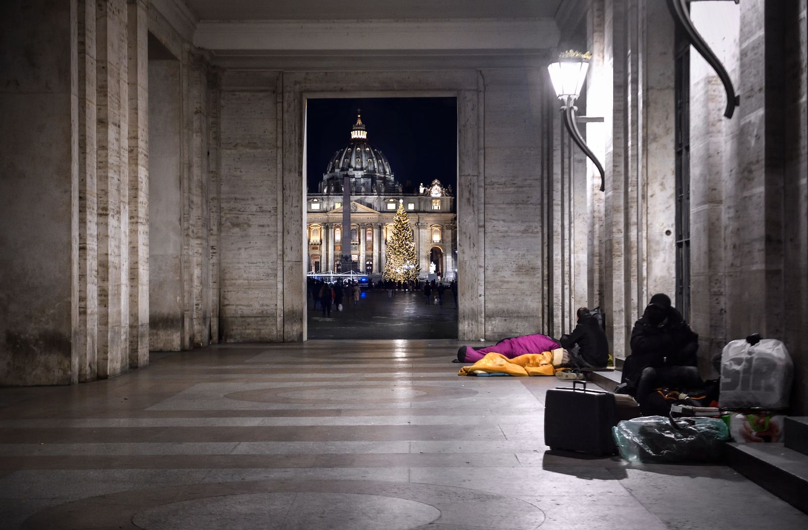 Homeless people sleeping near St. Peter's Square