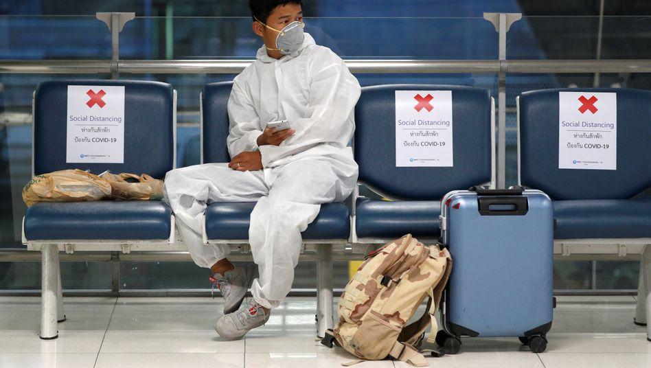 Das Coronavirus stellt die Zukunft der Globalisierung infrage (im Bild: ein Passagier auf dem Flughafen Bangkok)