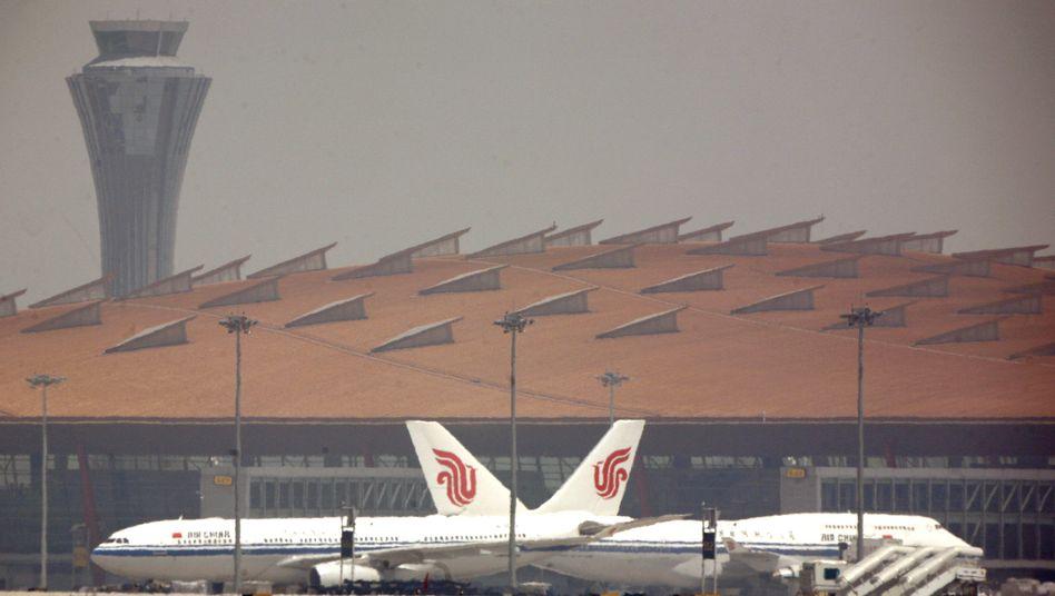 Maschinen von Air China auf dem Flughafen von Peking: Der Luftverkehr in Asien ist wegen der Ausbreitung des Coronavirus stark eingeschränkt.