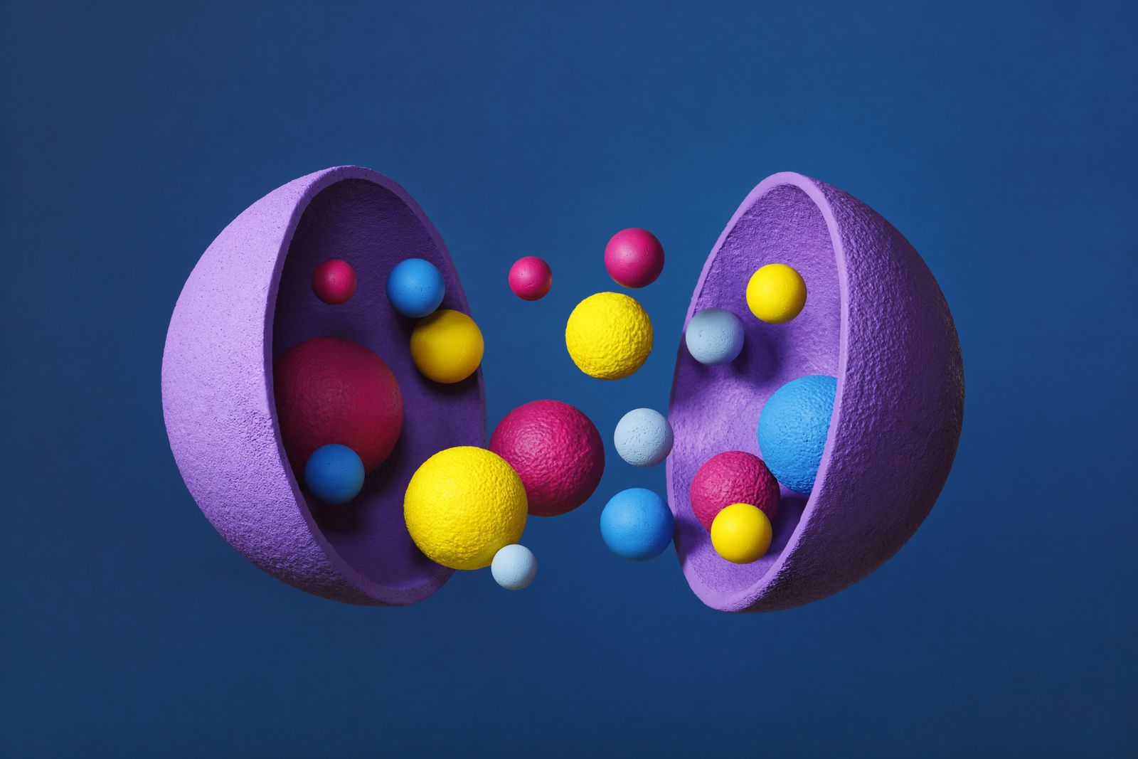 Abstract multi-colored objects levitation in mid air on blue background