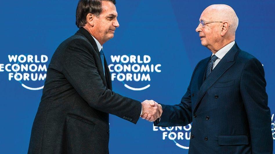 SCHATTENMANN WEF-Chairman Klaus Schwab (r.) begrüßt Brasiliens Präsidenten Jair Bolsonaro 2019 als Gast in Davos