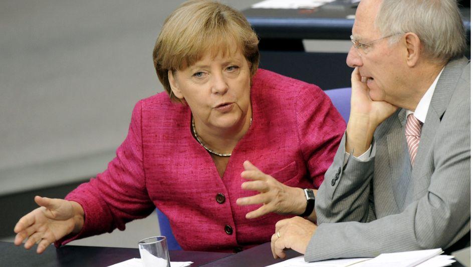 """Bundeskanzlerin Angela Merkel (CDU) und Bundesfinanzminister Wolfgang Schäuble (CDU): """"German Eiertanz"""""""