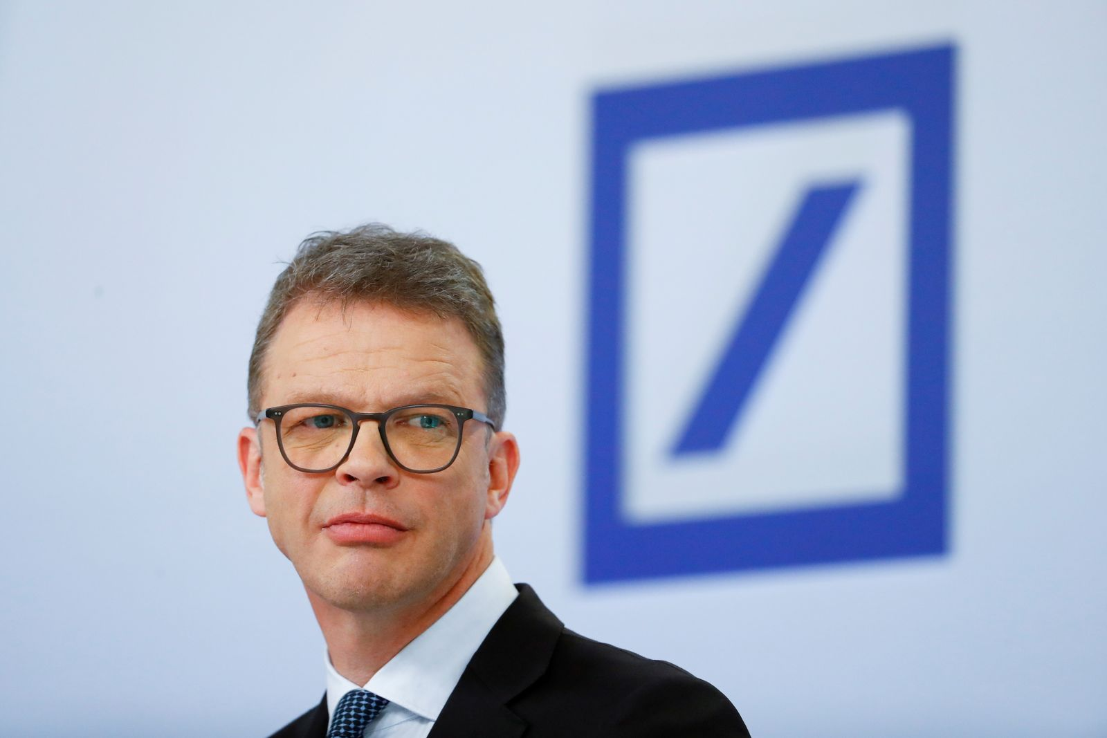 FILE PHOTO: Christian Sewing, CEO of Deutsche Bank AG, looks on during the bank's annual news conference in Frankfurt