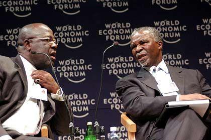 Genug Gold für Uhr und Manschettenknöpfe: Der Chef der Ashanti-Goldfelder Sam Jonah (links), hier mit dem südafrikanischen Präsidenten Thabo Mbeki