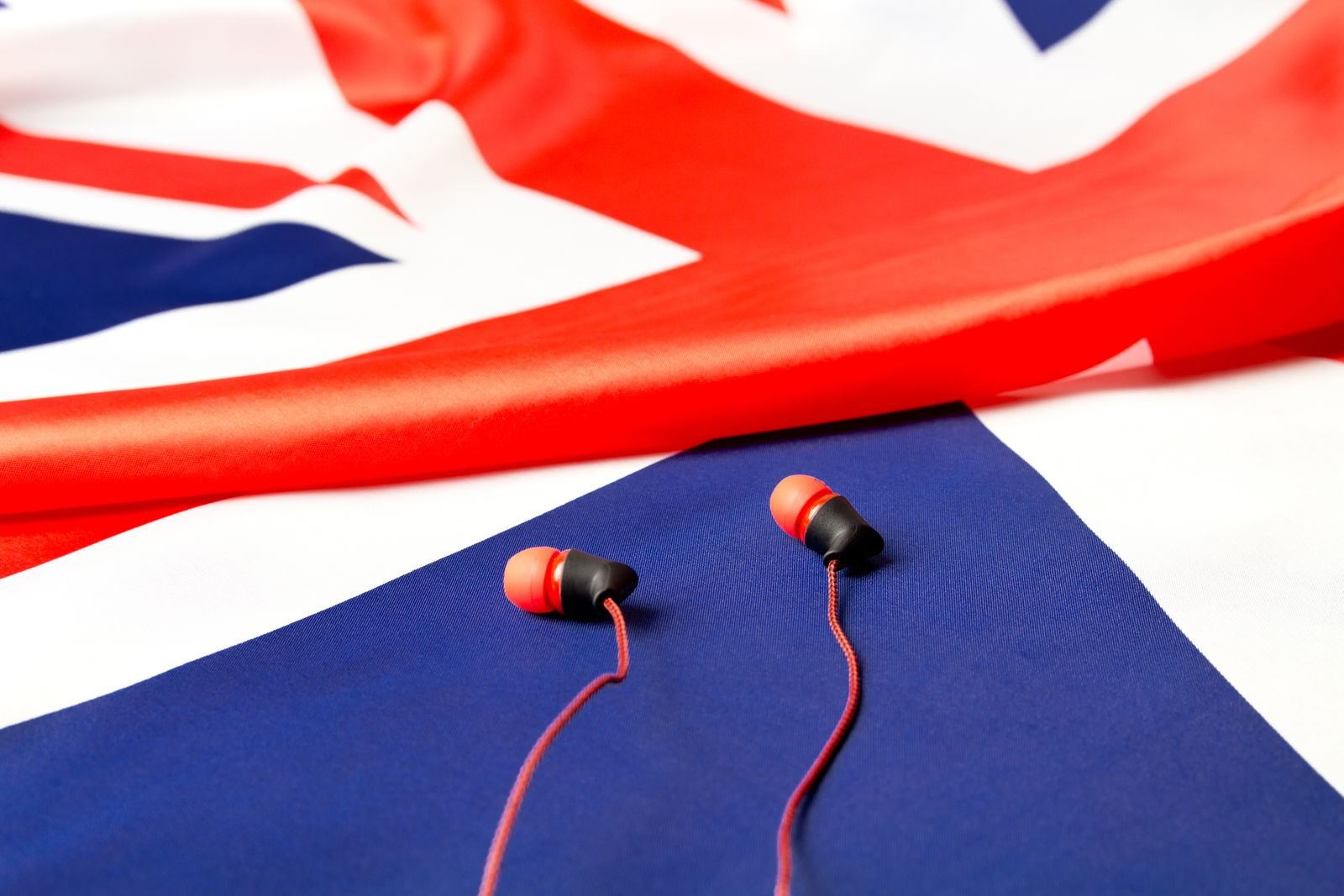 Learn English. British flag and headphones close-up.The Concept Of E-Learning English.