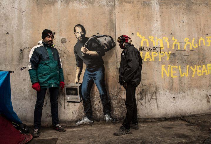 Eine Ikone der modernen Welt: Steve Jobs (Mitte, in einer Darstellung des Künstlers Banksy)