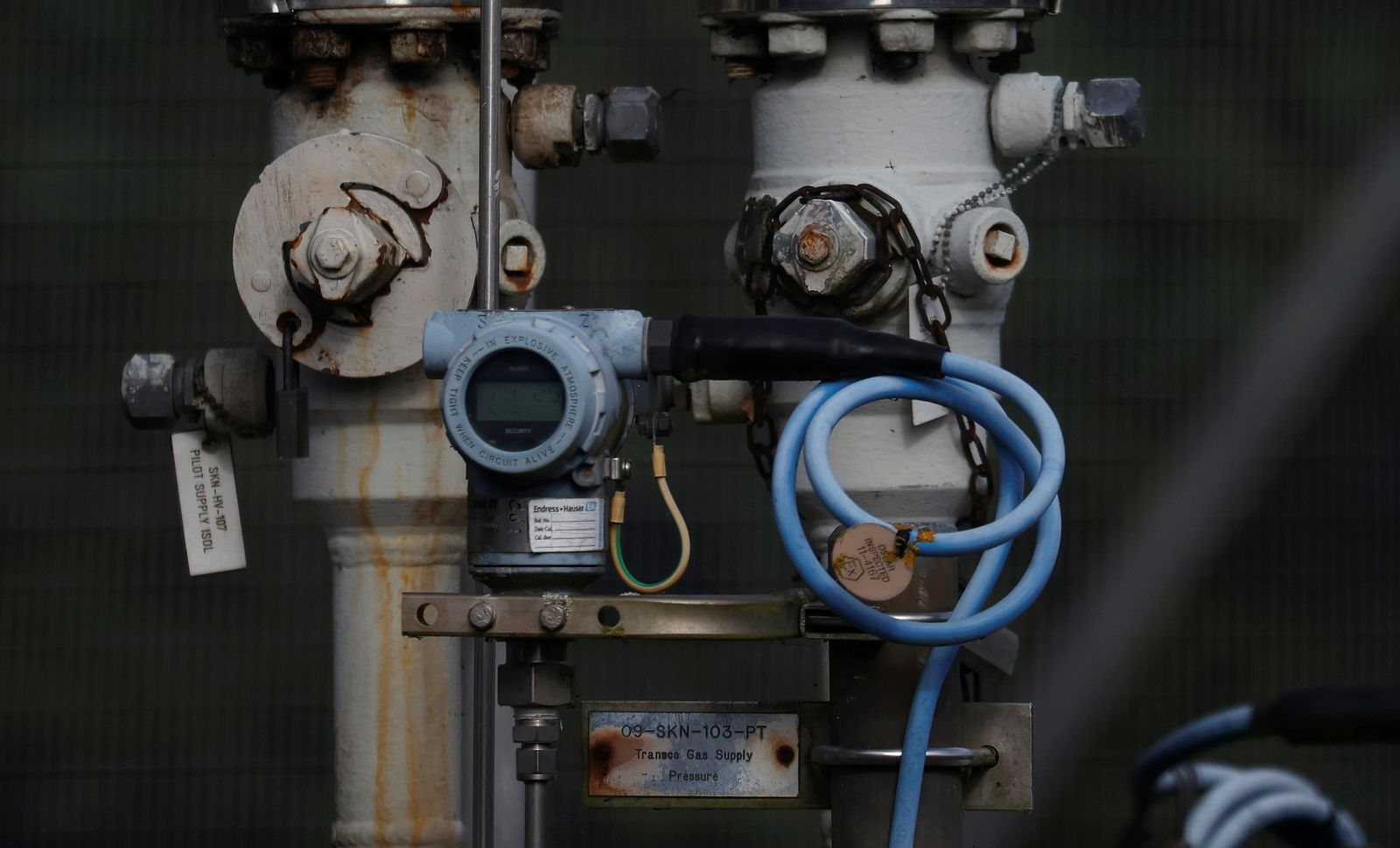 Dials and valves are seen near a section of gas pipeline at a National Grid facility near Knutsford