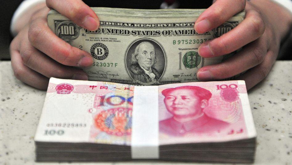 Yuan und Dollar: Für China ist derYuan-Kurs eine zweischneidige Angelegenheit