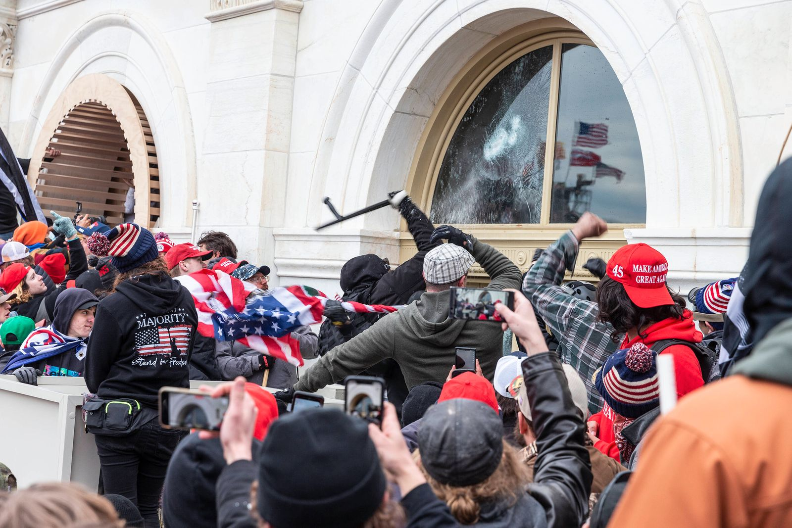 Pro-Trump Riot in Washington DC Pro-Trump protesters break windows of the Capitol building. Rioters broke windows and b
