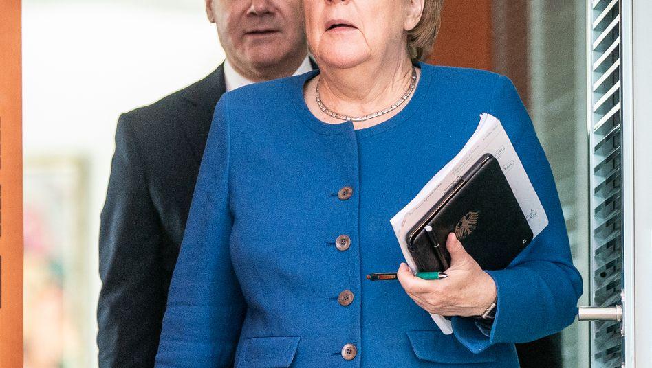 Krisenmanager: Bundeskanzlerin Angela Merkel und Finanzminister Olaf Scholz (hier bei einem Treffen Ende Oktober 2019)