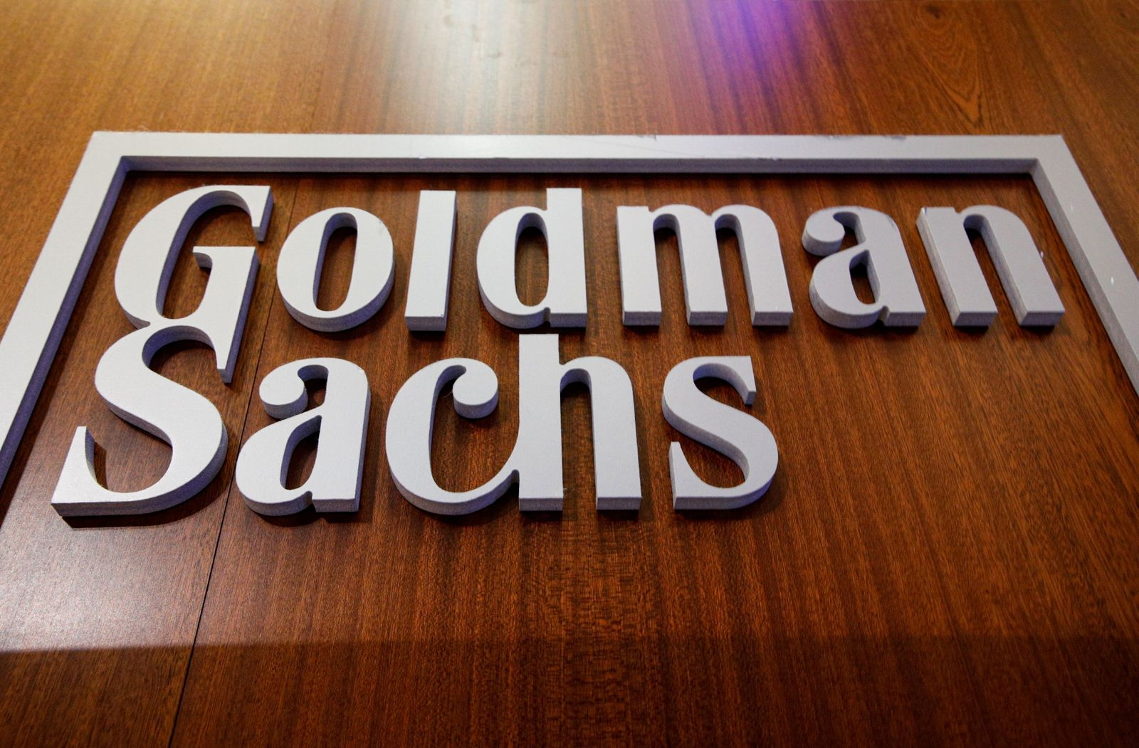 FILE PHOTO: The Goldman Sachs company logo is on the floor of the NYSE in New York