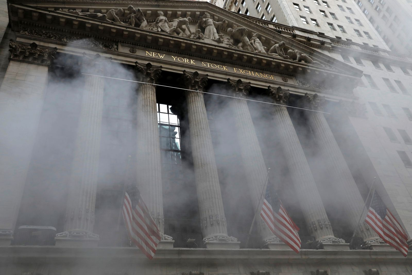 Steam rises in front of the New York Stock Exchange (NYSE) in Manhattan, New York City