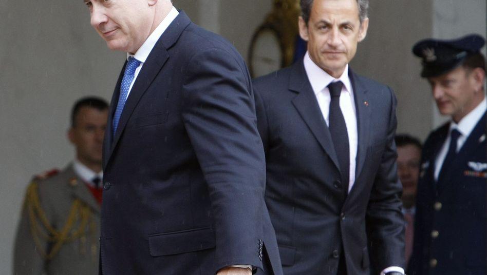 Politiker Netanjahu (links), Sarkozy: Wenig schmeichelhafte Worte beim G-20-Treffen
