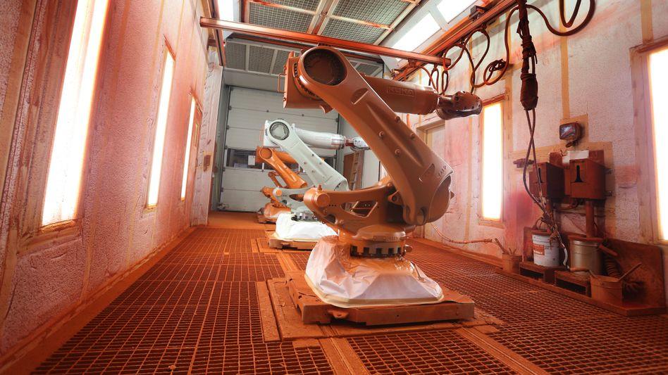 Wie rot ist die Zukunft? Roboterschmiede Kuka.