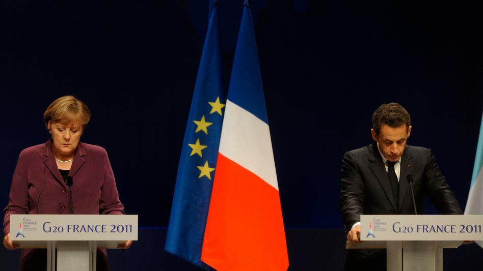 Ungleiches Retterpaar: Sarkozys Regierung muss für neue Schulden doppelt so hohe Zinsen zahlen wie die von Merkel