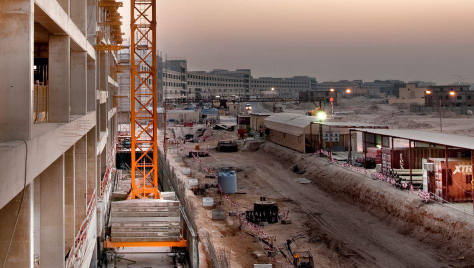 Hochtief-Baustelle in Katar: Der Konzern investiert weiter in das Baugeschäft und will Unternehmen in Kanada und Indien übernehmen
