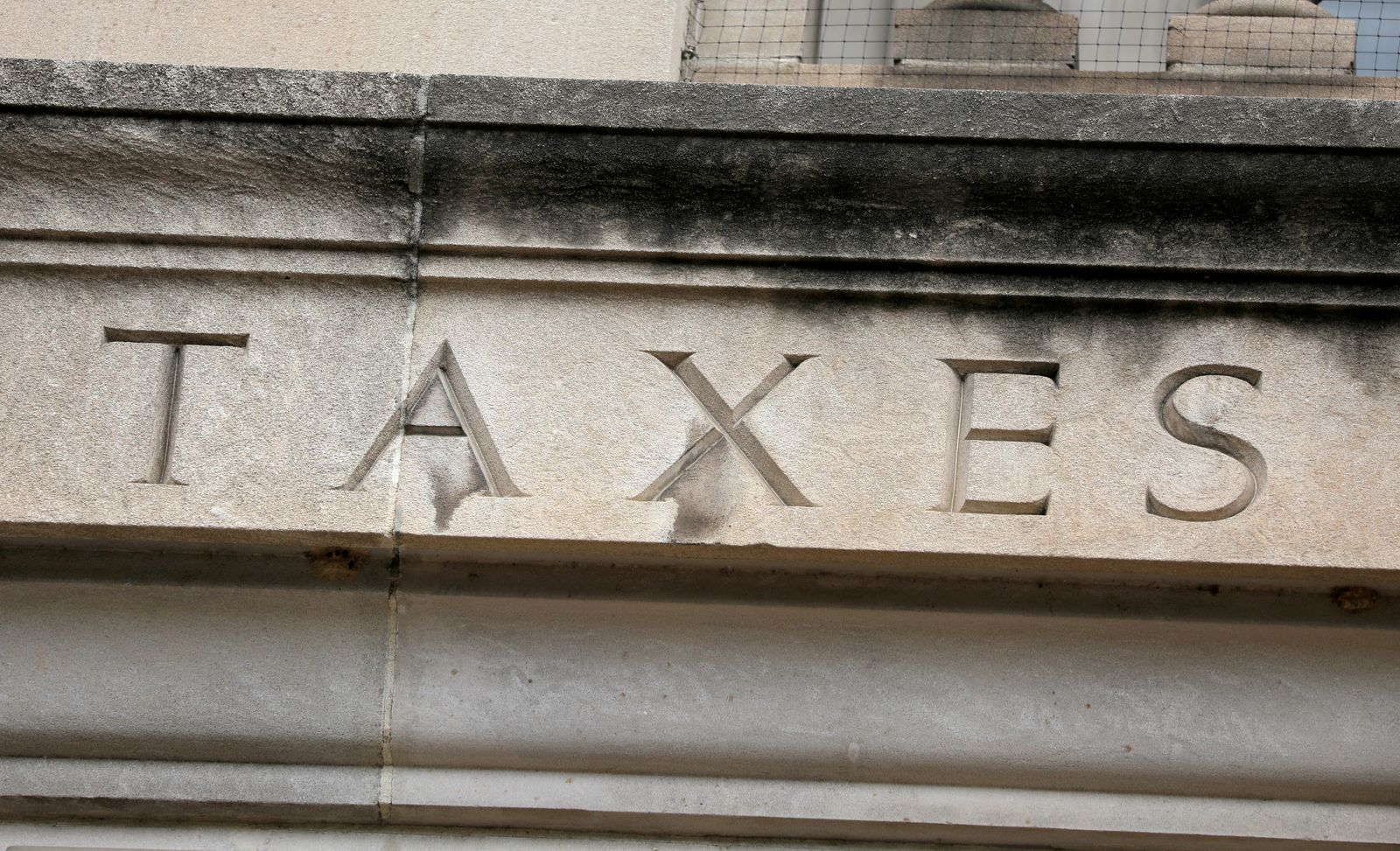 """FILE PHOTO: The word """"taxes"""" is seen engraved at the headquarters of the Internal Revenue Service (IRS) in Washington, D.C."""
