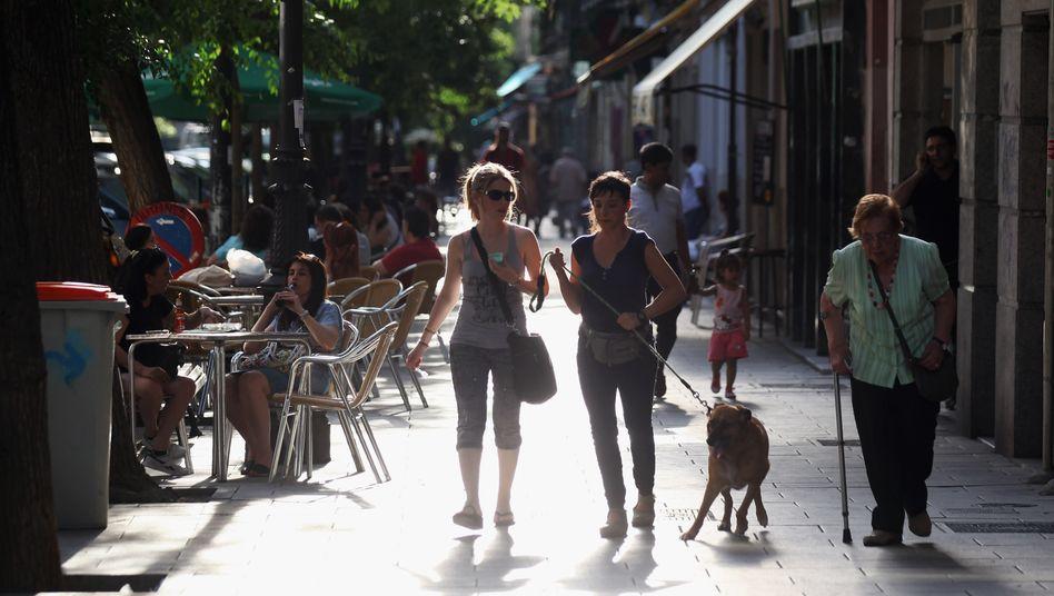 Straßenszene in Madrid: Die spanische Hauptstadt war bislang durch eine Vielzahl kleiner, inhabergeführter Geschäfte geprägt