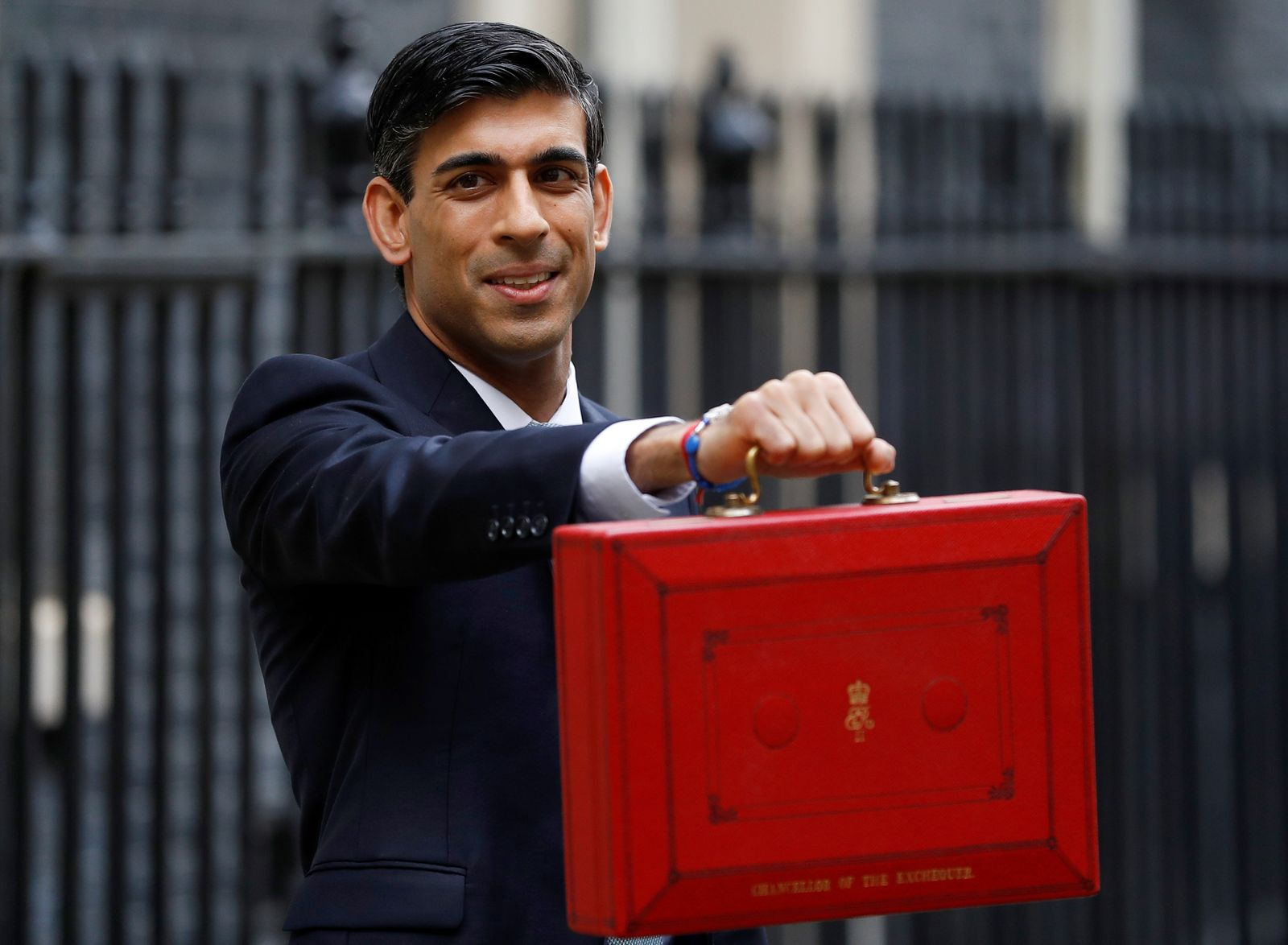 Britain's Chancellor of the Exchequer Rishi Sunak holds the budget box outside his office in Downing Street in London