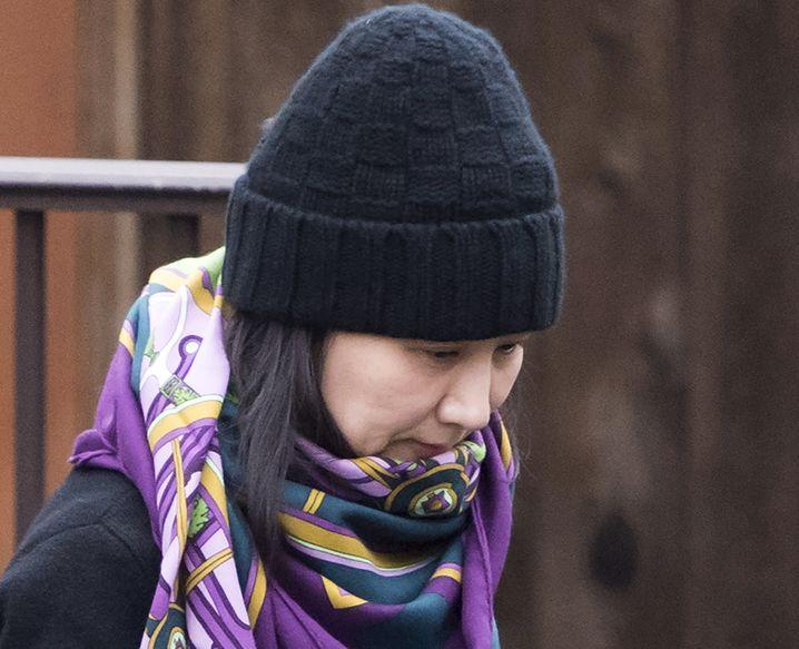 Huawei-Finanzchefin Meng Wanzhou: Behörden in Kanada halten sie fest, die Managerin kann nicht ausreisen. Die USA verlangen die Auslieferung der Managerin und Tochter des Gründers