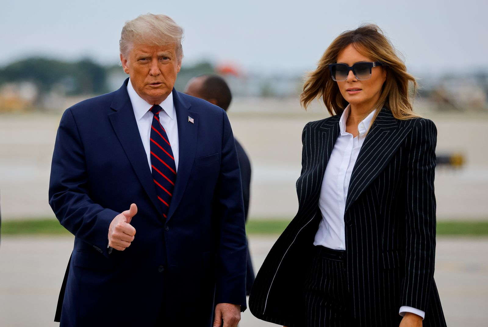 FILE PHOTO - U.S. President Donald Trump walks with first lady Melania Trump at Cleveland Hopkins International Airport in Cleveland